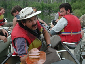 Using paddle as serving tray.  Explore the West Tours owner Richard Taylor receiving.